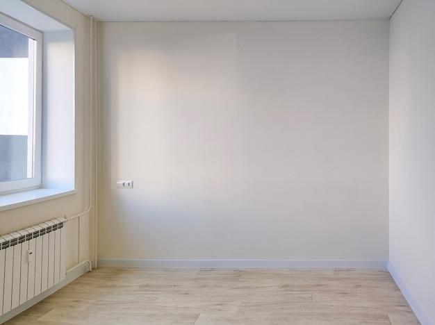 New empty white room with window -renovation