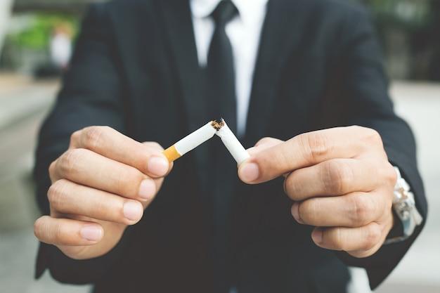 A new generation of businessman refusing cigarettes