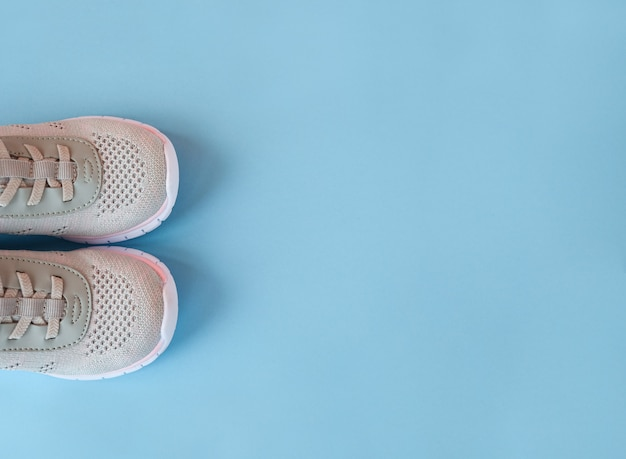 New grey sneakers on pastel blue background