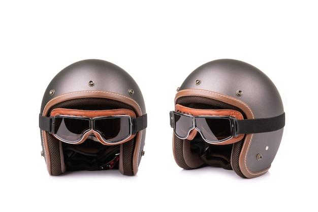 新しい灰色のビンテージヘルメットとウィンドゴーグル
