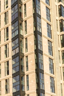 New high-rise building decorated with stone slabs with large windows