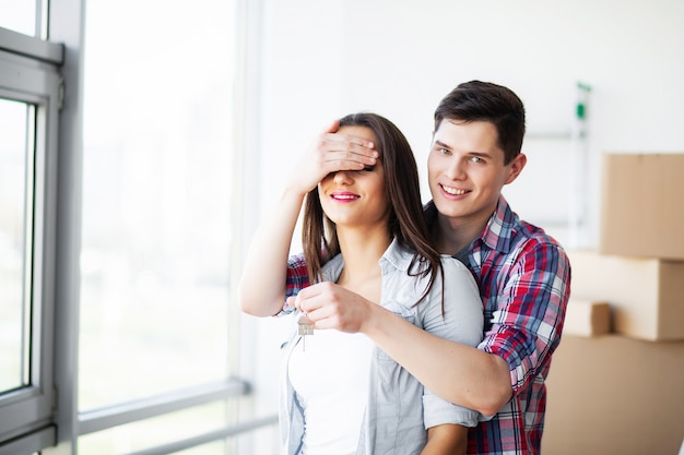 New home, funny young couple enjoy and celebrating moving to new home