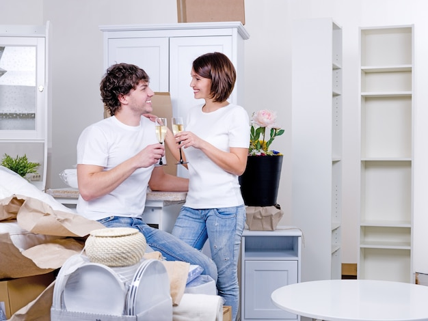 New home for young happy couple staying with stemwares