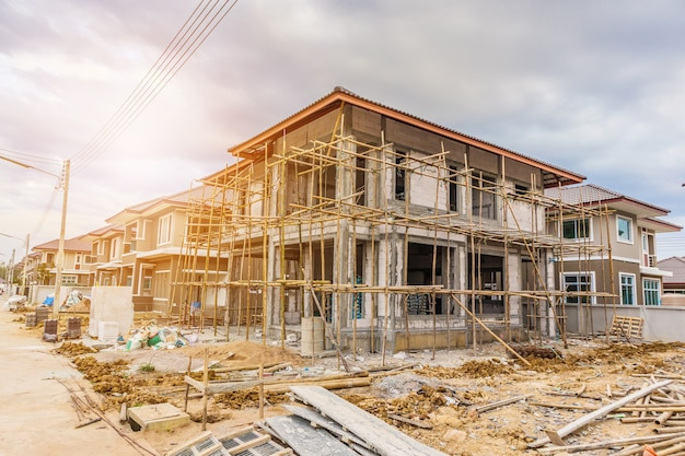New house under construction at building site