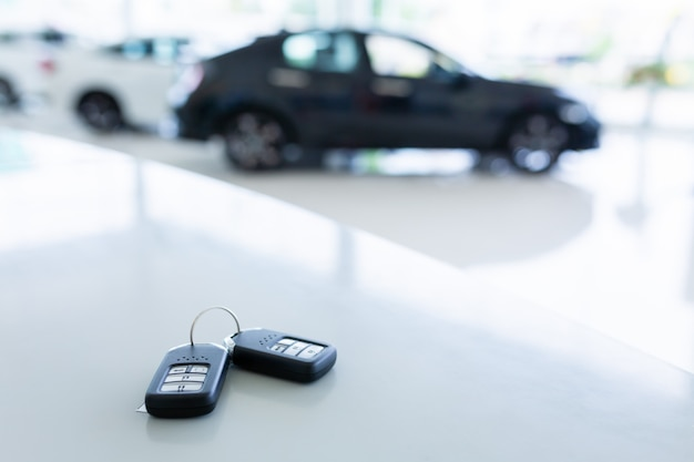 New key in car showrooms with two new remote keys placed on the work table in the new car showroom.