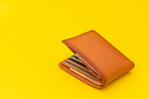 New leather brown men wallet on yellow