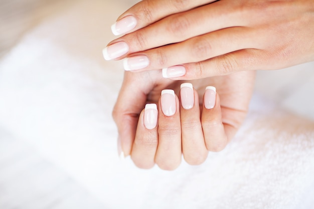 New manicure. side view of the process of manicure in salon. professional manicurist provides a service to the client
