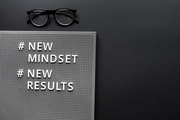 New mindset new result text on dark background.inspiration and  motivation concepts.copy space