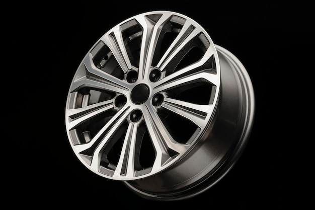 New modern alloy wheel with grey inserts, side view.