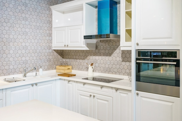 New modern, bright, clean, kitchen interior with stainless steel appliances in a luxury house