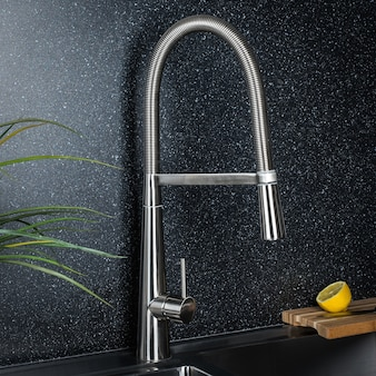 New and  modern steel faucet in the kitchen