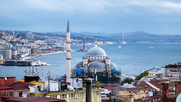 New mosque with bosphorus strait, moving ships and city, istanbul, turkey