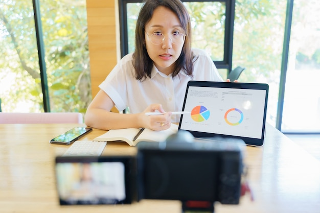 New normal asian woman aged 30-35 years, vlogger coach presentation training people online.