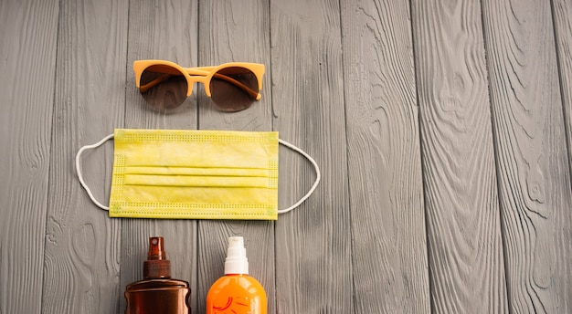 新しい通常のcovidフェイスマスク日焼け止めサングラス日焼け止めスプレーローション日焼け紫外線