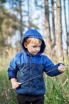 New normal escape step, wild nature walking and family outdoor recreation. kids cooking and tasting marshmallows fried on fire, hike at weekend, lifestyle