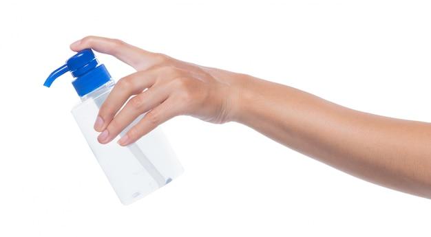 Новые нормальные люди промышленность образ жизни после covid-19 концепт, женский ручной дозатор дезинфицирующего средства алкоголь 70% бутылка с гелевым насосом
