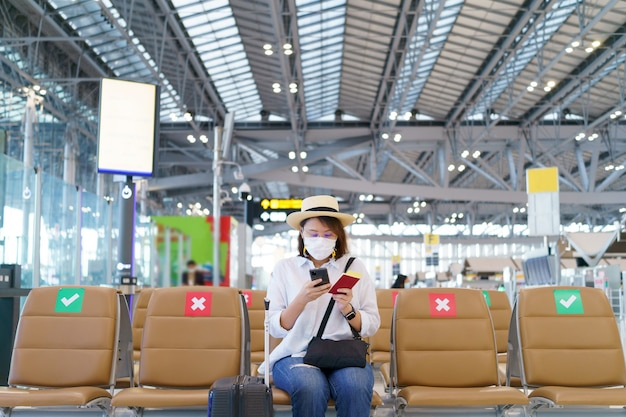 New normal tourist wearing face mask is traveling on the airport