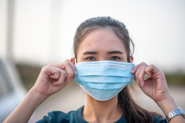 New normal woman wearing a dust mask and corona virus before traveling to various places in daily life