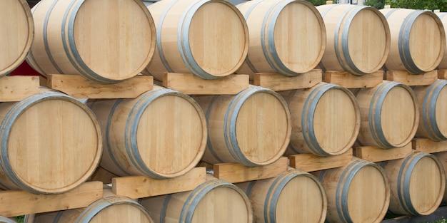 New oak barrels in a bordeaux wine cellar