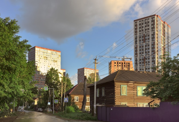 New and old houses in novosibirsk tall modern houses and old wooden houses in the area