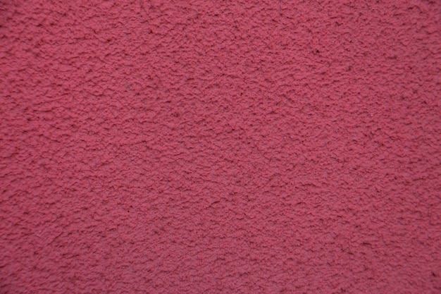 New pink cement wall. beautiful concrete stucco. painted cement. background texture wall