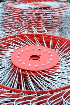 New red tedder for trailer in agricultural machinery for gathering hay. close up