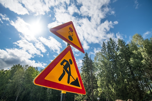 New road signs on a blue sky background