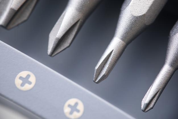 New set of sprockets for screwdriver closeup. repair and construction tools concept