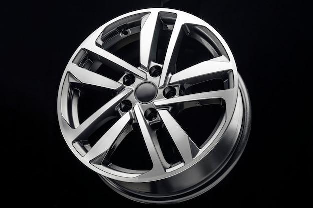 New shiny alloy wheel isolated on black