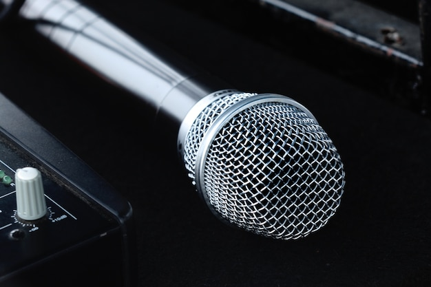 New silver microphone on black background