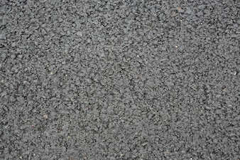 New smooth dark grey asphalt texture background.