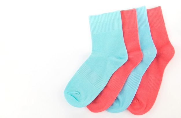 New socks on a white background. colorful socks with beige label for your design. isolated object