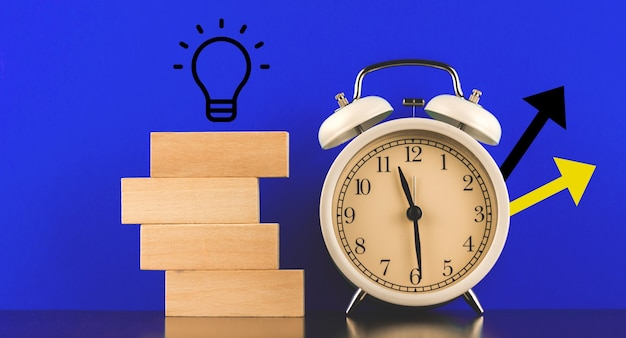 New startup idea concept banner for businessman and freelancer, blue background and alarm clock with icons, place for your text photo
