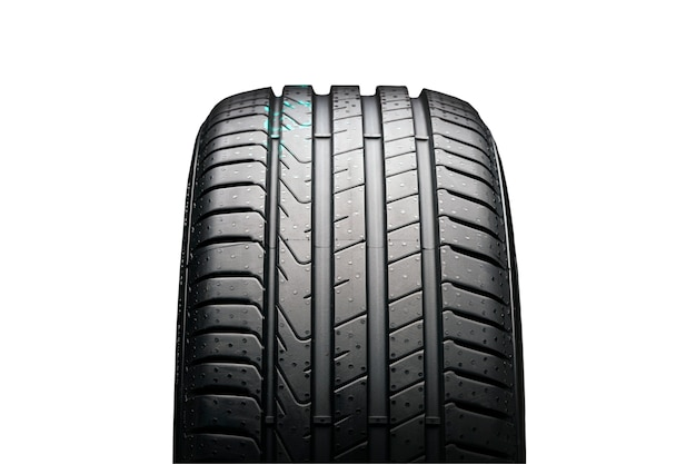 New summer tire on a black background, front view. isolate on a white background