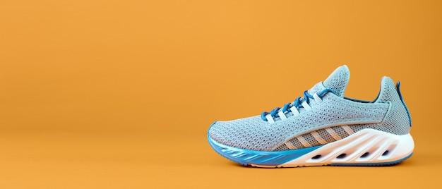 New unbranded running sneaker or trainer on orange background mens sport footwear