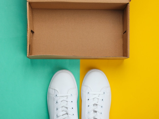 New white sneakers and  box on two-ton paper