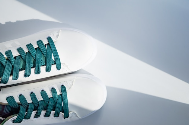 New white sneakers with green laces