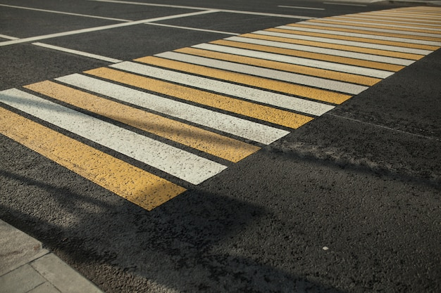 New white and yellow pedestrian in the city