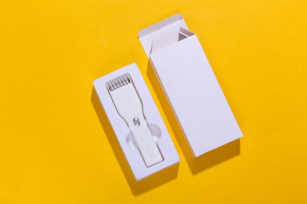 黄色の明るいボックスに新しいワイヤレスバリカン