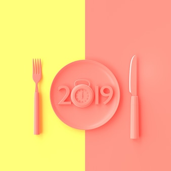 New year 2019 concept and clock pink color in plate with fork and knife.
