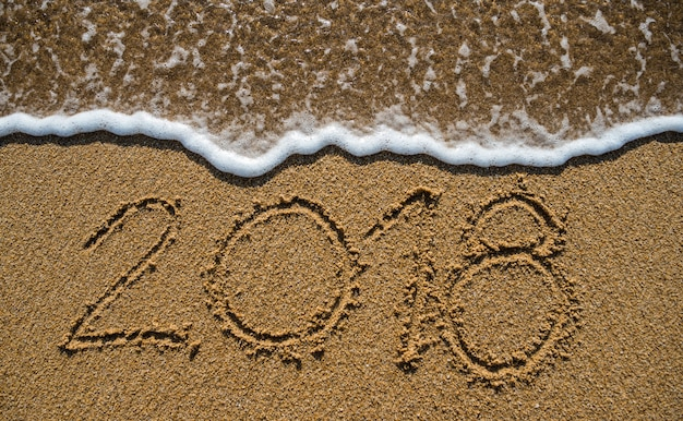 New year 2019 is coming concept. happy new year 2019 replace 2018 on the sea beach