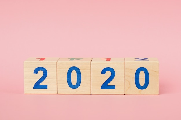 New year 2020 concept. wooden block cube with number