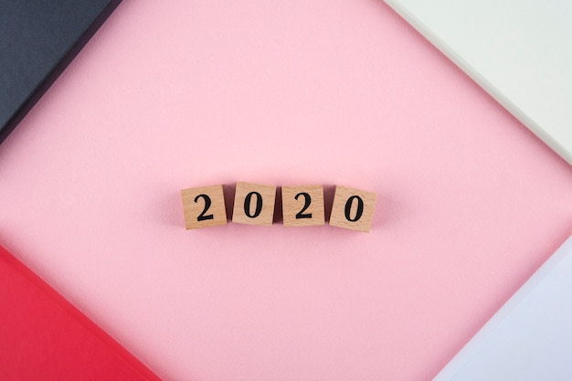 New year 2020 diary on pink background