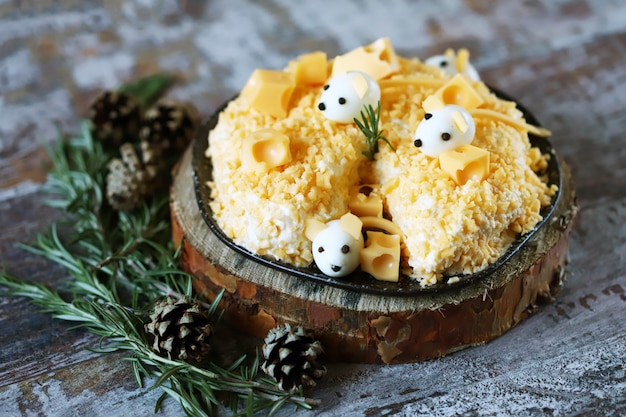 New year 2020 salad. mouse salad in cheese with pineapple and cheese. decorations in the form of egg mice.
