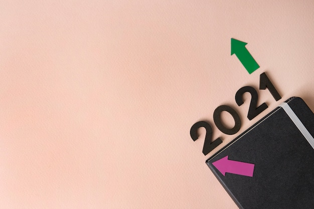 New year 2021 diary on pink surface