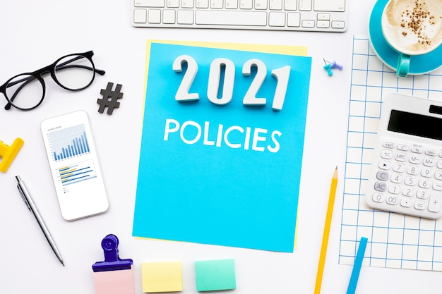New year 2021 policies concepts with text on desk. strategy management for success.business solution.top view