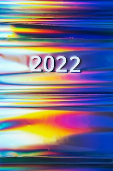 New year 2022 number on the colorful neon holographic background