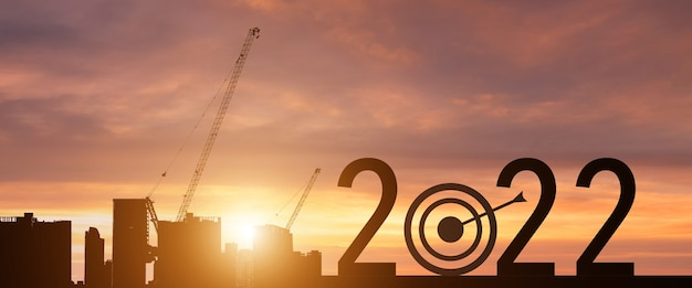 New year 2022 with a target to success silhouette.startup concept.