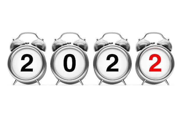 新年とメリークリスマスのコンセプト。白い背景の上の2022年の新年のサインと目覚まし時計。 3dレンダリング