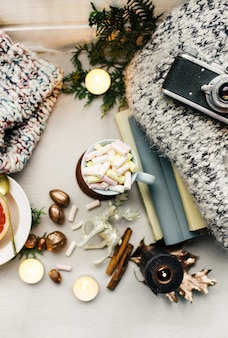 New year atmosphere and candle christmas toys with cup of coffee